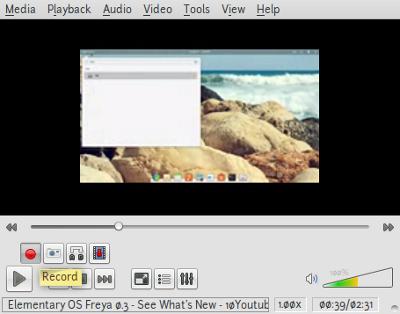 Screenshot-Elementary OS Freya 0.3 - See What's New - 10Youtube.com.3gp - VLC media player-1